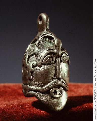 Pendant. Shows the characteristic helmet of the Vendel and early Viking period, with the raised eyebrow guards and the beak on the forehead. Country of Origin: Sweden. Culture: Viking. Date/Period: 10th C. Place of Origin: Ostergotland. Material Size: silver. Credit Line: Werner Forman Archive/ Statens Historiska Museum, Stockholm . Location: 18.