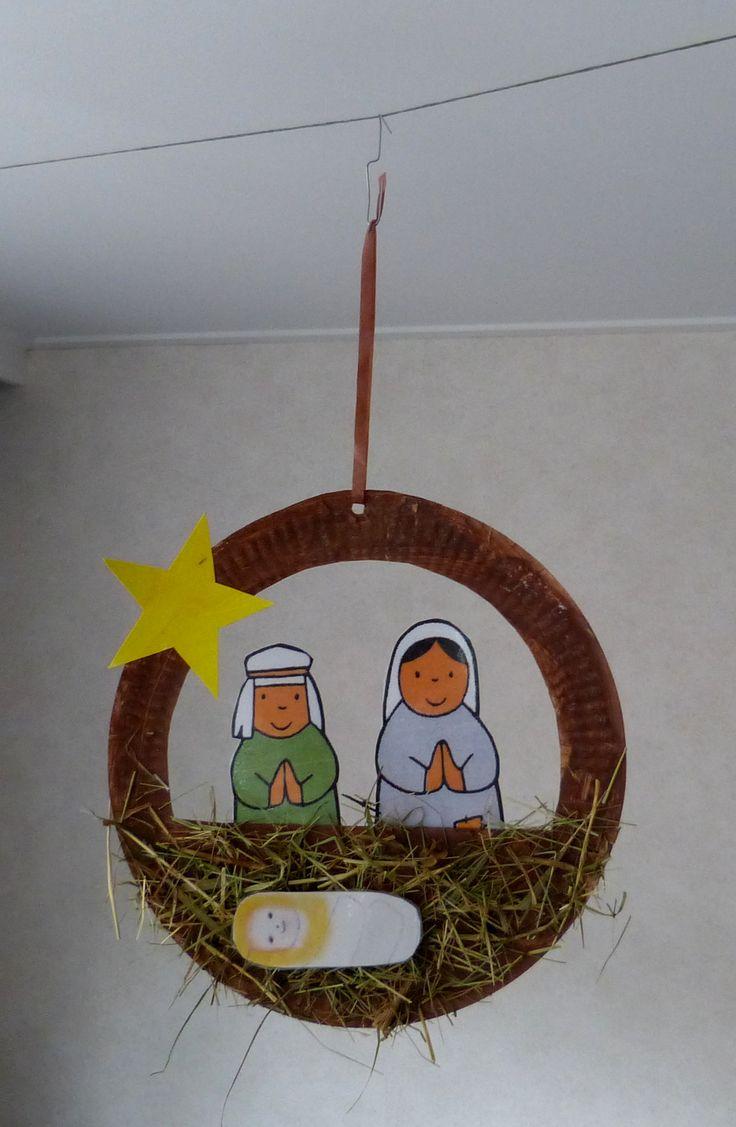 Jozef en Maria met kindje Jezus in de kribbe.