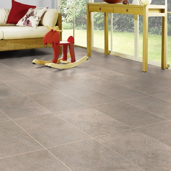 "Karndean ST13 Portland Stone Knight Tile Vinyl Flooring has warm beige and mid-grey tones, offering a classic limestone look. Presented in a 12""x18"" tile format for increased layout options. The strip displayed between tiles is DS10 3mm design strip."