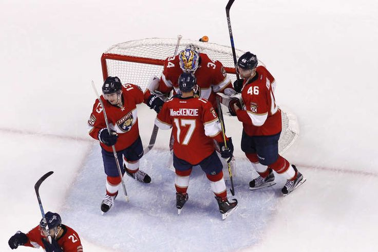 SUNRISE, FL - MARCH 14: Goaltender James Reimer #34 of the Florida Panthers celebrates the victory against the Toronto Maple Leafs with Mark Pysyk #13, Derek MacKenzie #17, and Jakub Kindl #46 at the BB&T Center on March 14, 2017 in Sunrise, Florida. The Panthers defeated the Maple Leafs 7-2. (Photo by Joel Auerbach/Getty Images)