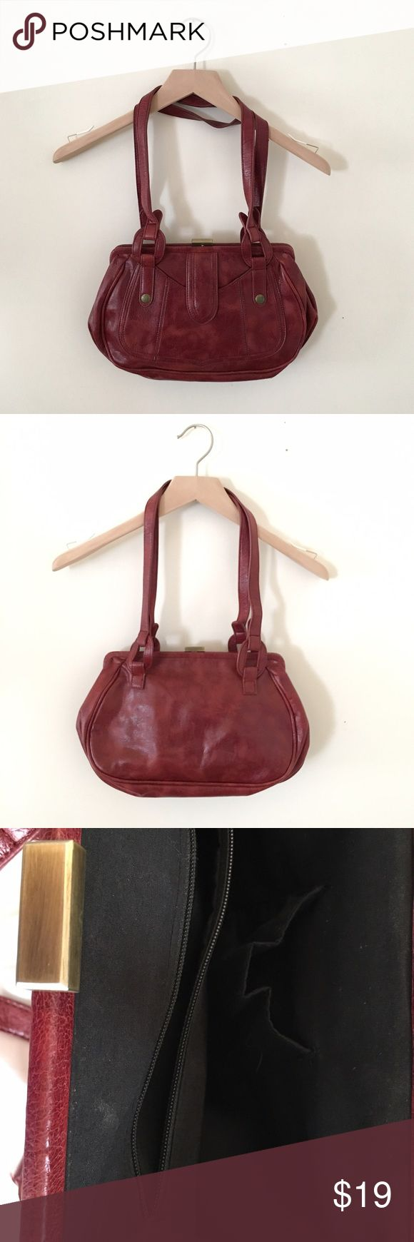 Urban Outfitters Burgundy Purse Leather burgundy purse with interior pockets. Over the shoulder strap with cute detail. Urban Outfitters Bags Shoulder Bags