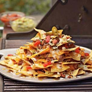 The most amazing nachos over - on the most amazing grill pan ever. I think people come over for the nachos more so than to see us!