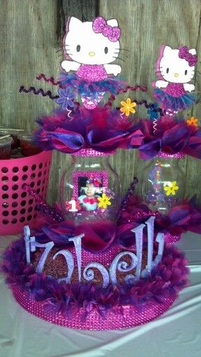 Hello Kitty themed party, bigger centerpiece is for cake table and smaller ones without birthday girl pic are for the table centerpieces.