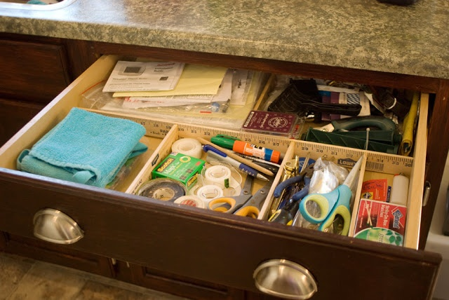 Use yardsticks to organize your junk drawer
