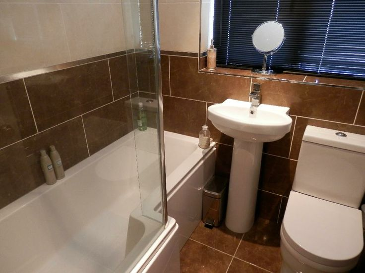 Alan from Sandhurst #VPShareYourStyle these brown floor tiles really make the white shower bath standout in this bathroom.
