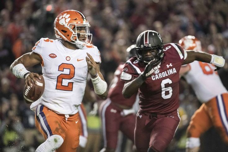 Clemson quarterback Kelly Bryant (2) scrambles from the pocket against South Carolina linebacker T.J. Brunson (6) during the first half of an NCAA college football game Saturday, Nov. 25, 2017, in Columbia, S.C. Clemson defeated South Carolina 34-10. (AP Photo/Sean Rayford)