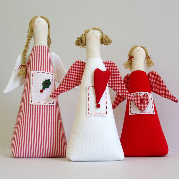 Fabric, triangular, table angels in red and white sahdes decorated with hearts, stitches, buttons and bells.
