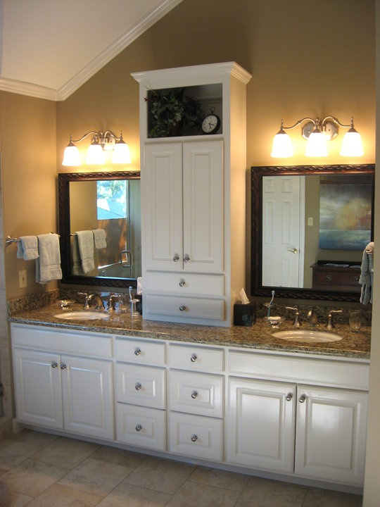 custom vanity with linen tower and pull out trash can etc