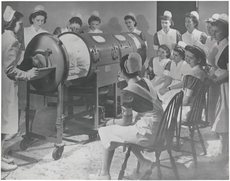 Instructing nurses on the use of respirator for a polio patient, May 23, 1958.  It was called an iron lung.