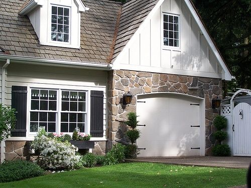 Cottage style stone front and carriage style garage door for Garage cottage