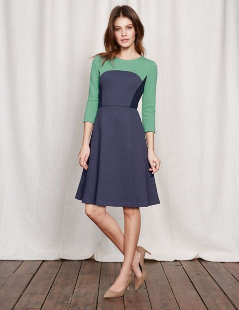 With a fitted bodice, full skirt and three-quarter-length sleeves, three really is a magic number. Our fit-and-flare dress is ultra-flattering in textured jacquard fabric. Don't waste precious time agonising over what shoes to pair it with – it looks equally great with heels or flats.
