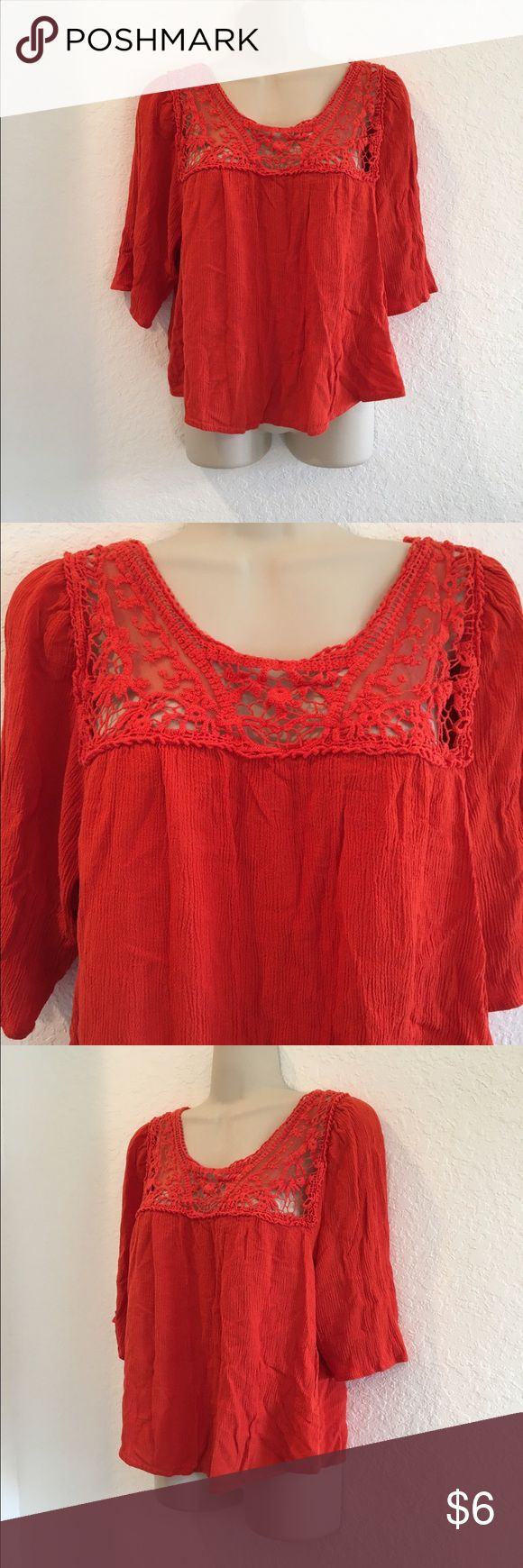 Cute Petite Shirt A beautiful reddish-orange top with crochet detailing around the neckline. It's been worn but it's still in good condition. Unique Spectrum Tops Blouses