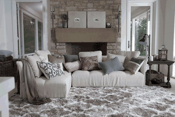 1- Start with a deep seated lounging sectional couch and a rug in neutral colors and hues.