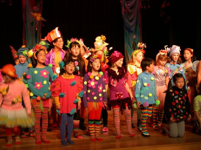 Munchkins: colorful tights, pom poms, flowers, bright colored tshirts, tutus, headpieces