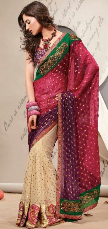 Fun colors... The saree looks especially wonderful with the big Jewelry