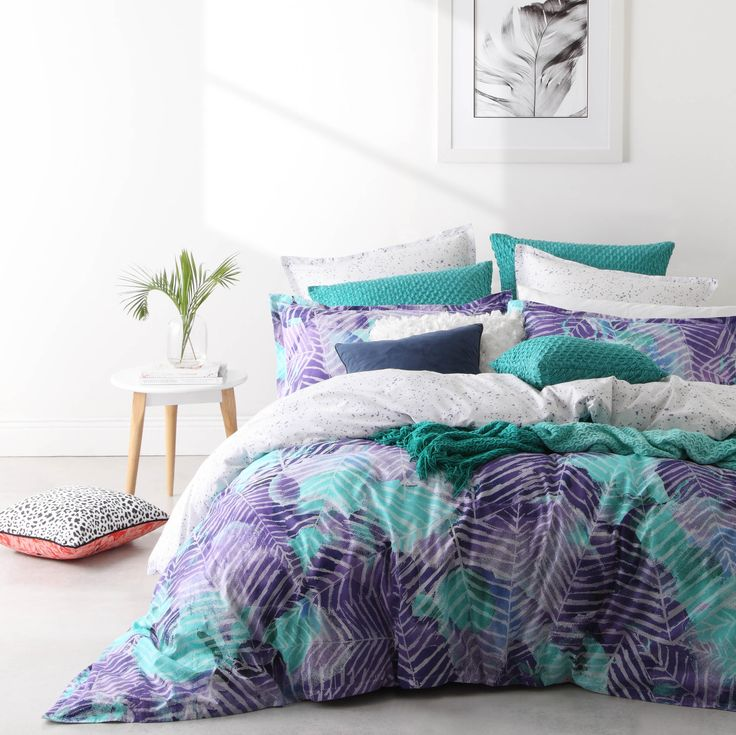 Havana Teal combines tropics with the new pixelation trend. Large sweeps of purple and teal are shaped into tropical palms by careful placement of white, mixed with pixelated areas and blended tones to give a relaxed, painterly look. The printed reverse features a purple dot pattern for contemporary contrast. #loganandmason