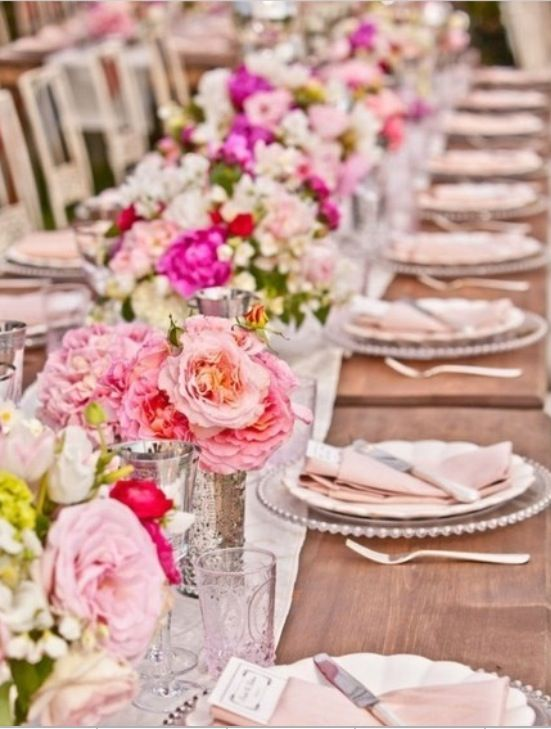 Place setting inspiration, pink centerpieces and tan table linens.