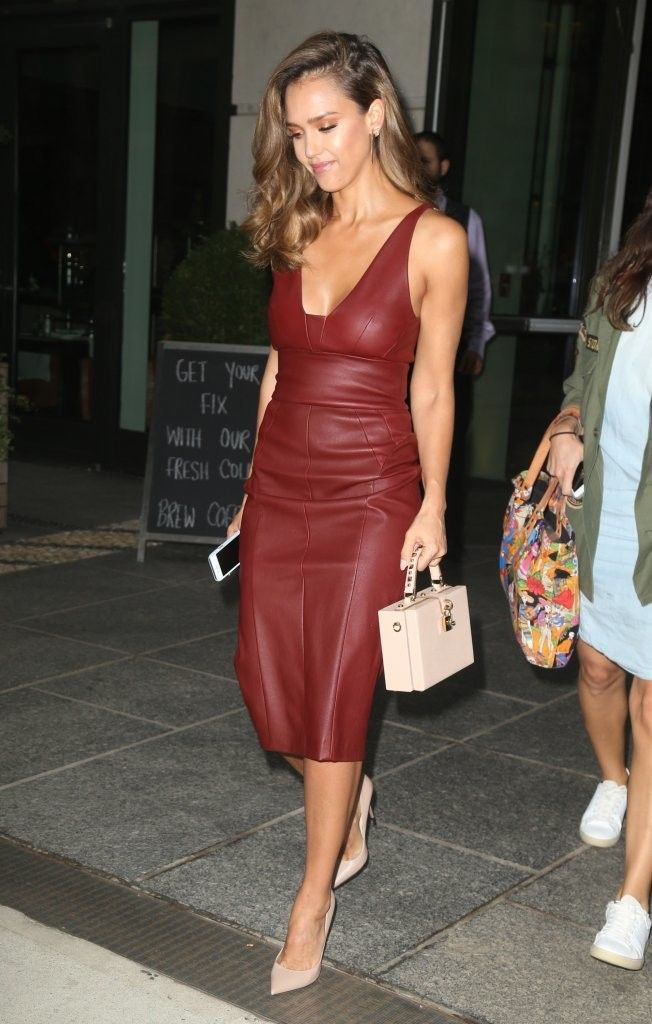 Jessica Alba cut a sleek figure in her maroon Narciso Rodriguez midi dress while stepping out in New York City. The actress pared down her look with classic touches such as her Dolce & Gabbana box purse and Jimmy Choo heels.