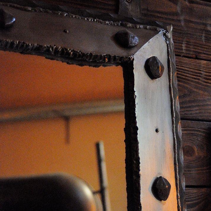 Metal mirror frame welded from scrap. Surindustrialle Gallery in Lodz / Poland. Scrap metal art, welding applied art and jewellery