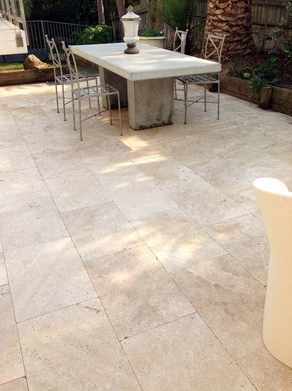 European style courtyard in Fairlight. The job was done by Stephen Nugent Paving & Landscaping, the stone was supplied by Gaia Stone.