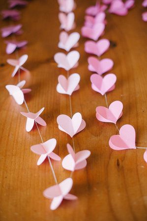 DIY: Strung Heart Garland #wedding decoration. Thinking about trying it with an ombre effect in purple and orange