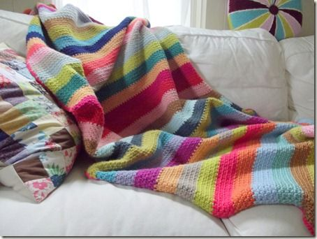 Beach Stripe Surf Blanket... made with the woven stitch, which is nothing more than sc, ch1 across, and then on the next row, the single crochets go in the ch1 spaces, and the chain 1s go above the single crochets. Link to a photo tutorial.
