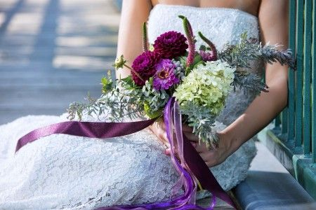 Late summer bridal bouquet of purple and lavender zinnias, hydrangea and other locally grown garden flowers