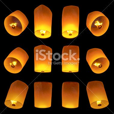 beautiful Lanterns flying isolated on black background - Stock Image