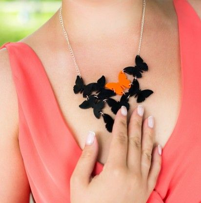 Butterfly necklace in Black and Orange by @KiviMeri. Made in Finland.