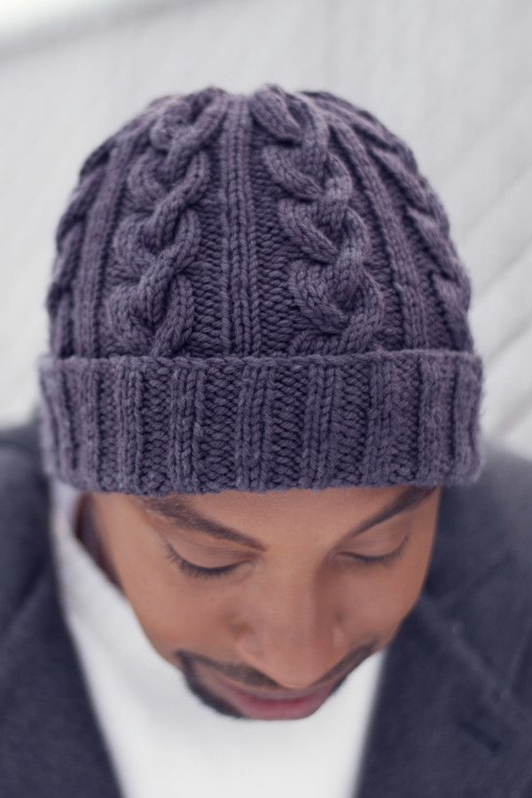 Cabled knitted hat pattern in charcoal gray
