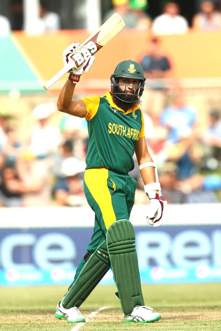 Hashim Amla of South Africa celebrates his century during the Pool B, Match 24 between South Africa and Ireland at Manuka Oval on March 3, 2015 in Canberra, Australia.