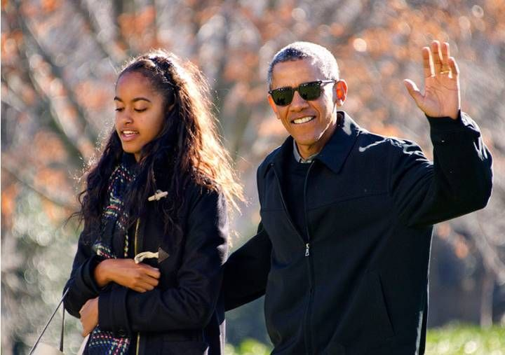 <p>President Barack Obama waves to the assembled press as he walks with his daughter Malia on his family's return to the South Lawn of the White House January 3, 2016 in Washington, DC. The first family is returning from their two week Hawaiian vacation</