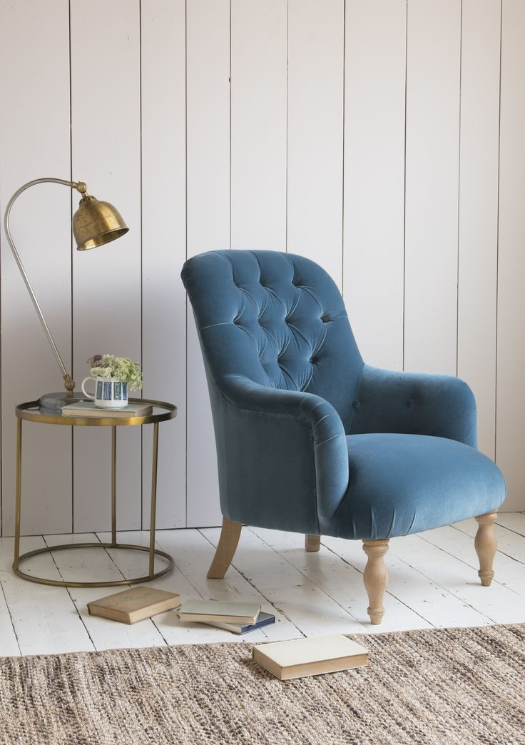 Loaf's deep blue Flump armchair with hand-pleats and button detailing Loaf.com