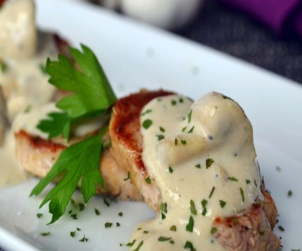 A delicious Spanish Tapas recipe - tender Spanish pork tenderloin with an extremely creamy homemade mushroom sauce.