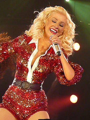 """Christina Aguilera singing """"What A Girl Wants"""" during the """"Back to Basics World Tour"""". Xtina wore a red sequin """"Santa"""" outfit."""