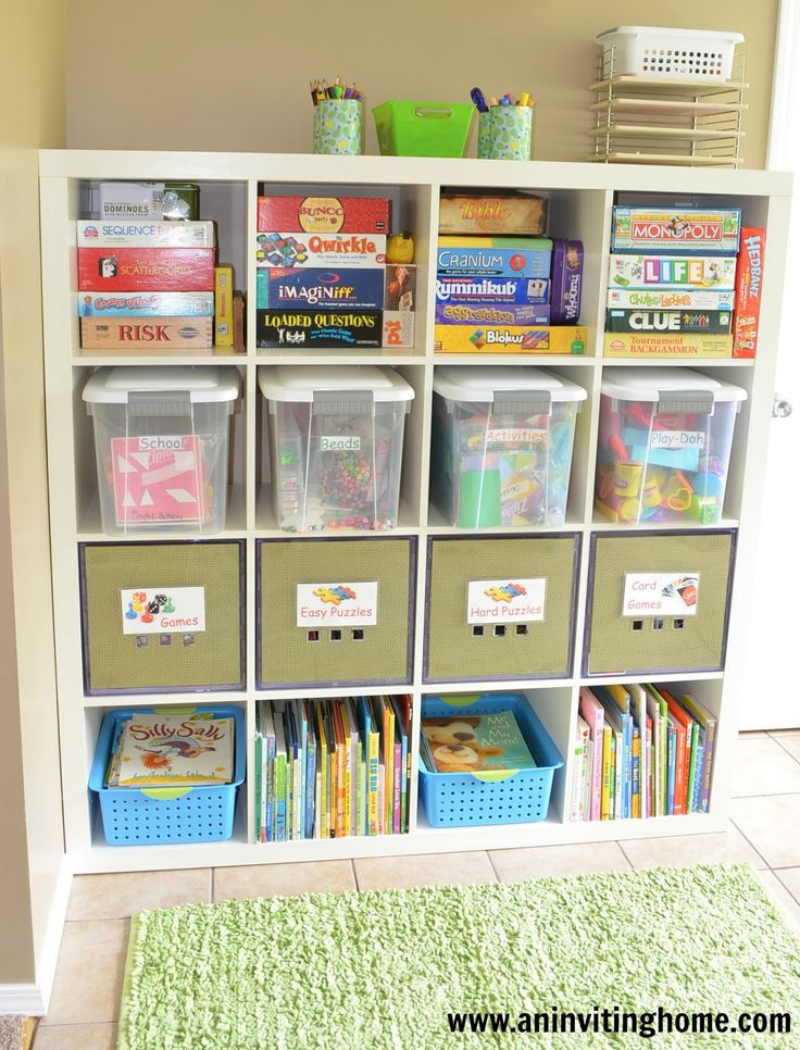 6 tips to organizing a kids play room. (This is ikea expedit shelving in white).