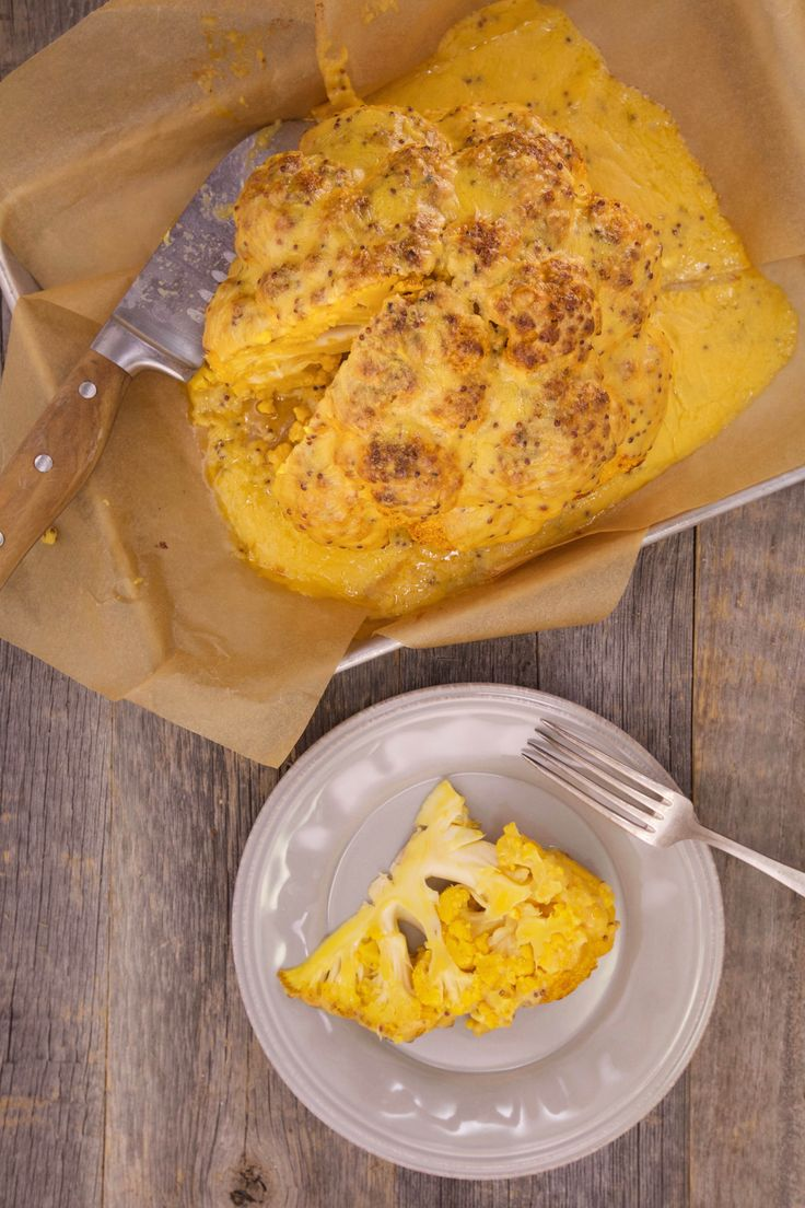 Cover this whole roasted cauliflower with a creamy Welsh rarebit sauce to add a unique twist on this trendy dish.