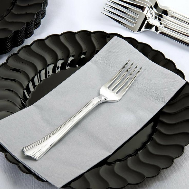 Plastic forks. I used these at my wedding and I thought they looked nicer than different colored silverware. :) $22.10 for case of 600. There are spoons and knives too.