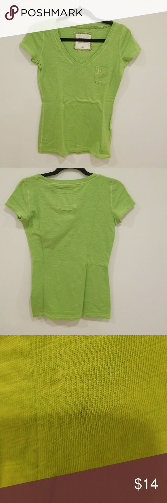 Abercrombie and Fitch Green V-Neck T-Shirt Abercrombie and Fitch Green V-Neck T-Shirt. A slight mark on the top back as seen in the third picture. Gently used. Abercrombie & Fitch Tops Tees - Short Sleeve