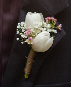 White tulip, wax flower, and baby's breath mother of the bride corsage with twine http://weddingflowersbyemily.blogspot.com/