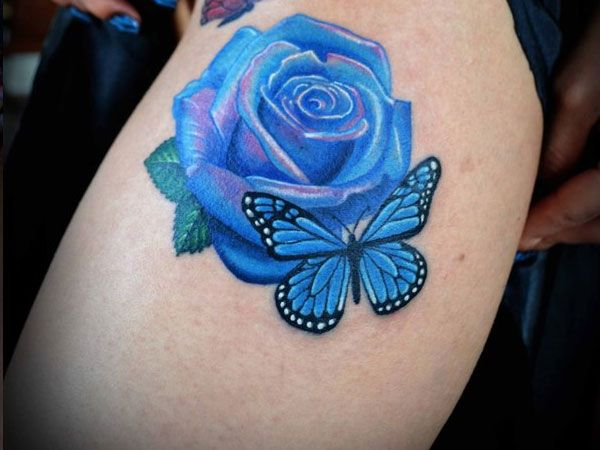 Beautiful blue rose and butterfly tattoo