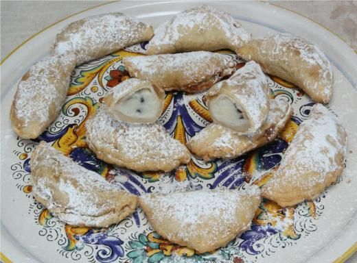 Cassatedde  -   Which is an Italian Pastry(cookie-like), that is STUFFED w/a Canoli-type Filling