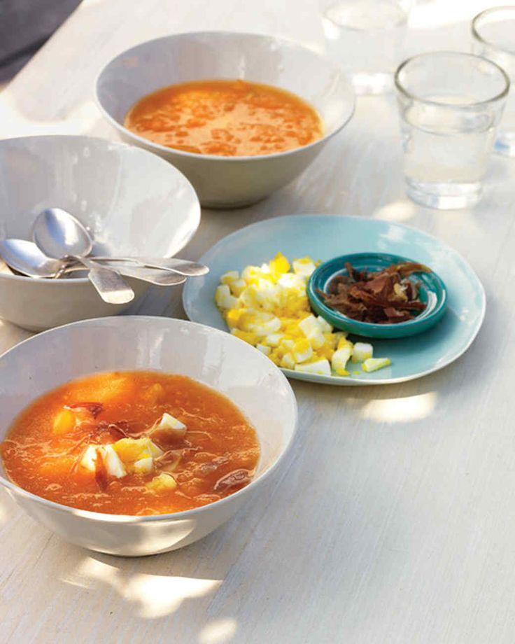 Yellow and orange tomatoes, shredded on a box grater, give this gazpacho a sunny hue and slightly chunky texture. Chopped egg and serrano ham are two traditional garnishes. Grating the tomatoes by hand gives the gazpacho a chunky consistency that can't be achieved with a food processor.