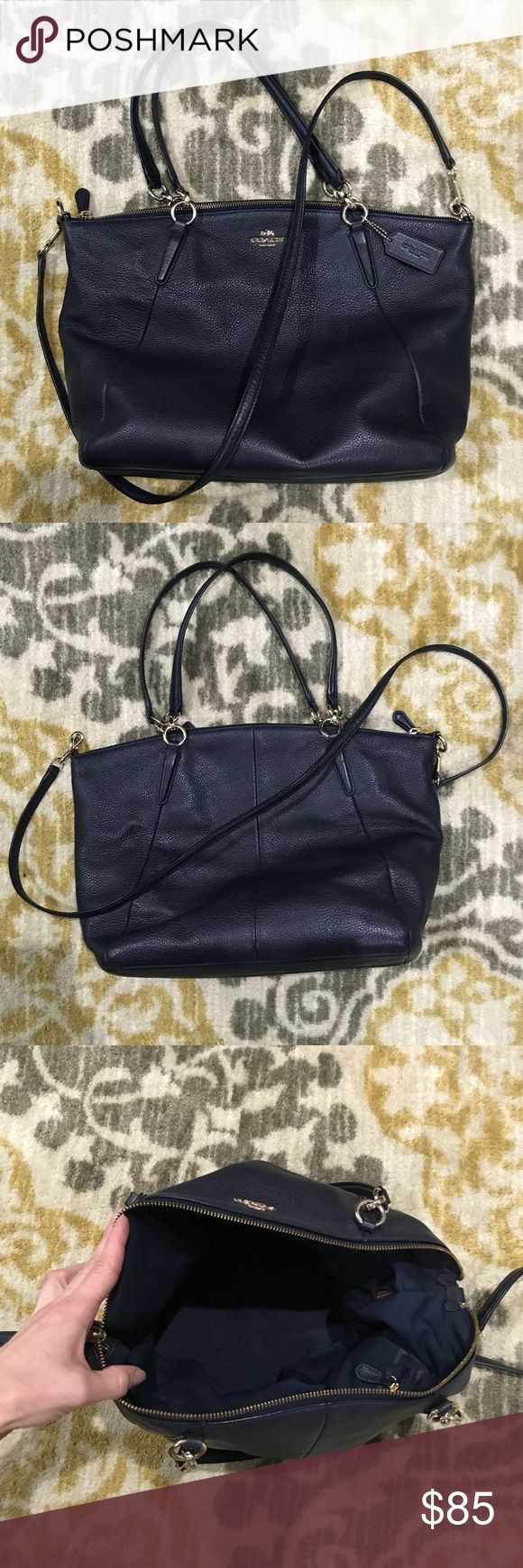 "Gorgeous Navy Leather Coach Satchel Beautiful navy leather Coach satchel! Great color that goes with so much! Versatile too! Can be worn over the shoulder or as a crossbody. Slight wear (see last two pics of bottom and shoulder straps) from being my everyday carry but overall in great condition! Dimensions: App. 16"" wide. 10"" tall. Coach Bags Satchels"