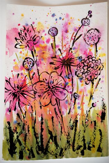 You begin with a very abstract watercolor and after it has dried you go back with India ink and a bamboo skewer and create flowers out of the watercolor splots (sorry, couldn't think of a better word.)