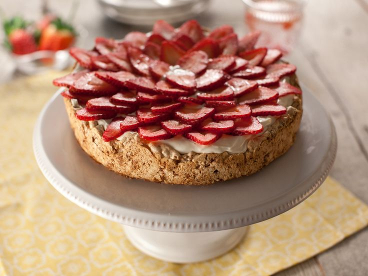 Strawberry Meringue Cake (Mostachon)   Have made this several times and it always a hit and very easy to make. The hardest part is placing the berries on it. :-)