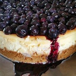 "Lemon Souffle Cheesecake with Blueberry Topping | ""I really think this recipe is outstanding! My boyfriend LITERALLY licked his plate clean!"""