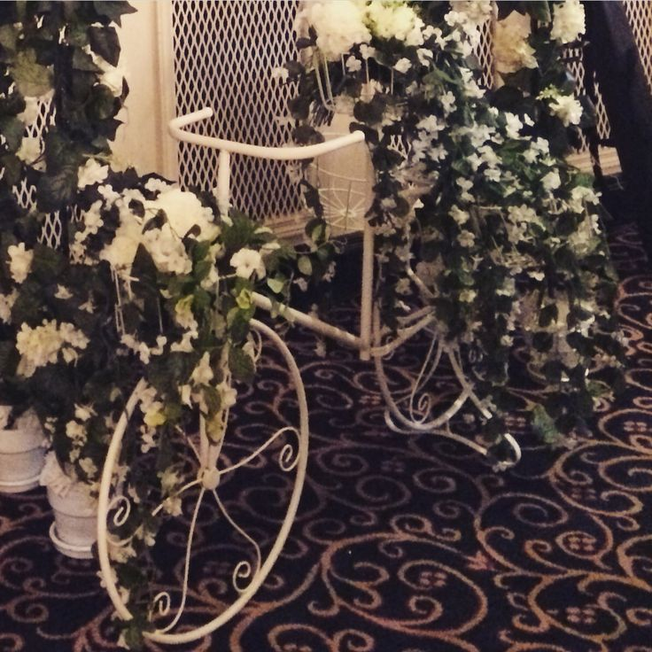 Vintage Style Bicycle filled with flowers by Cherry Blossom Weddings http://www.cherryblossomweddings.net