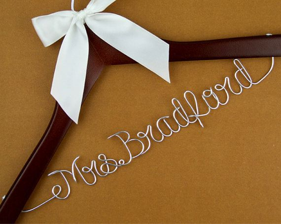 This is a personalized wedding hanger, which means you can ask me to make any name or phrase for you, as long as its in English and within the 14
