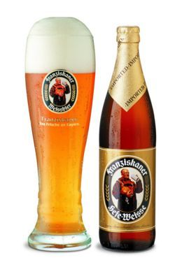 Franziskaner Heffeweizen is a wonderfully drinkable beer, particularly on warmer sunny days.  Pour into a pilsner and float a lemon slice on top, even if it angers the purists